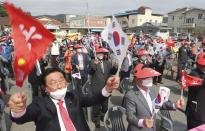 Local residents attend a rally calling for a pardon of Samsung Electronics' Vice Chairman Lee Jae-yong in Uiryeong, South Korea, on May 12, 2021. Pressure is mounting on South Korean President Moon Jae-in to pardon Samsung heir Lee Jae-yong, who is back in prison after his conviction in a massive corruption scandal, even though business has rarely looked better at South Korea's largest company. (Kim Dong-min/Yonhap via AP)