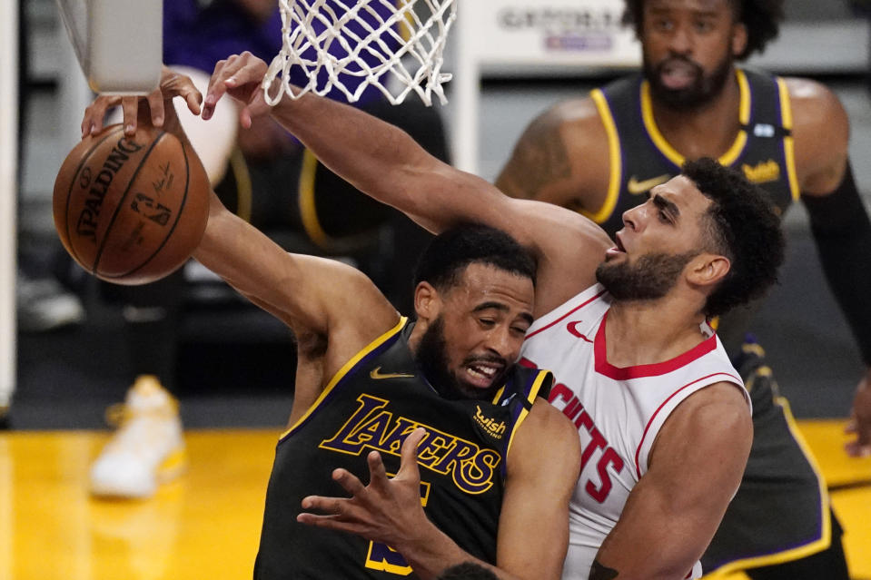 Los Angeles Lakers guard Talen Horton-Tucker, left, grabs a rebound away from Houston Rockets forward Anthony Lamb during the second half of an NBA basketball game Wednesday, May 12, 2021, in Los Angeles. (AP Photo/Mark J. Terrill)