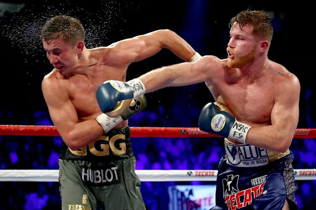 Canelo Alvarez throws a punch at Gennady Golovkin during their WBC, WBA and IBF middleweight championship bout at T-Mobile Arena in Las Vegas, Nevada, on September 16, 2017 (AFP Photo/AL BELLO)