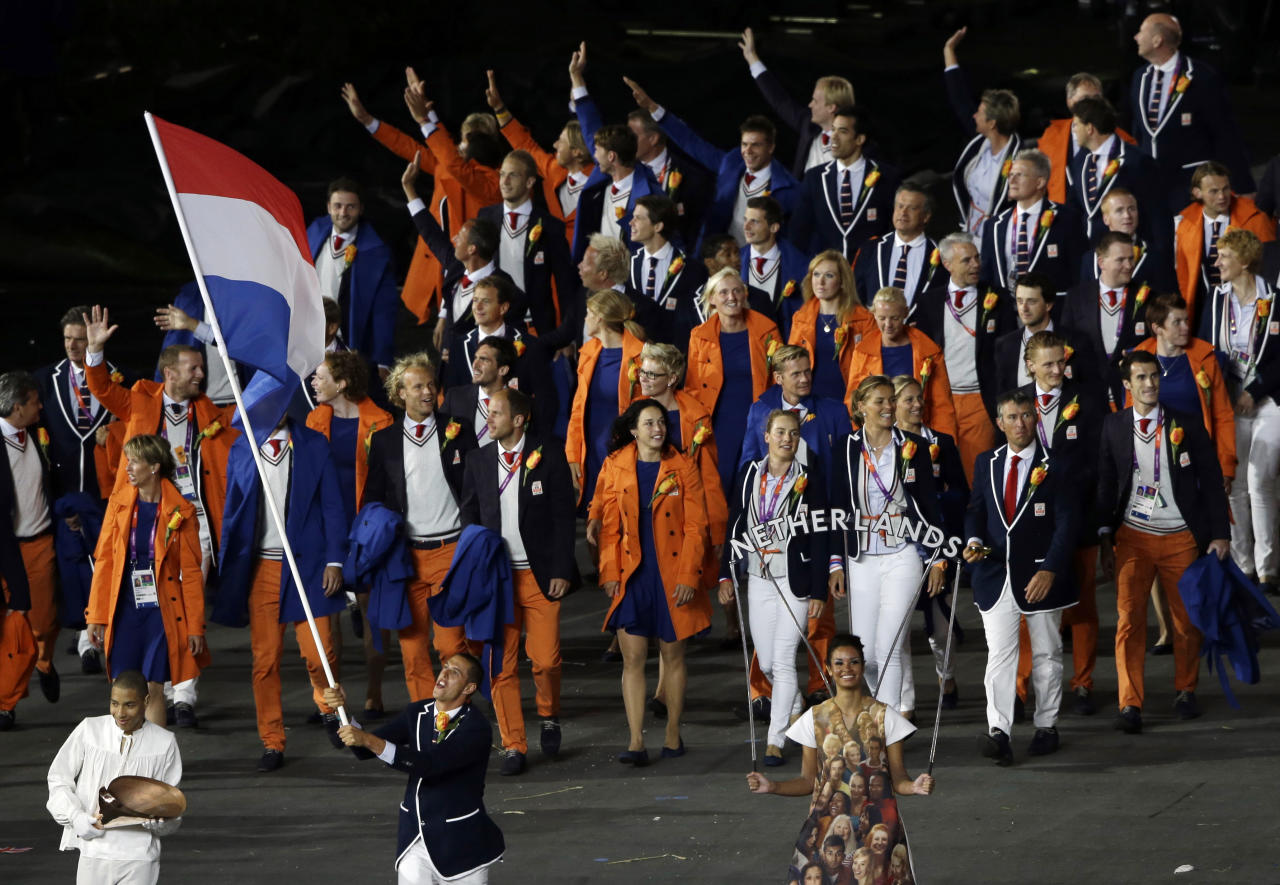 Netherlands' Dorian van Rijsselberghe carries the flag during the Opening Ceremony at the 2012 Summer Olympics, Friday, July 27, 2012, in London. (AP Photo/Paul Sancya)