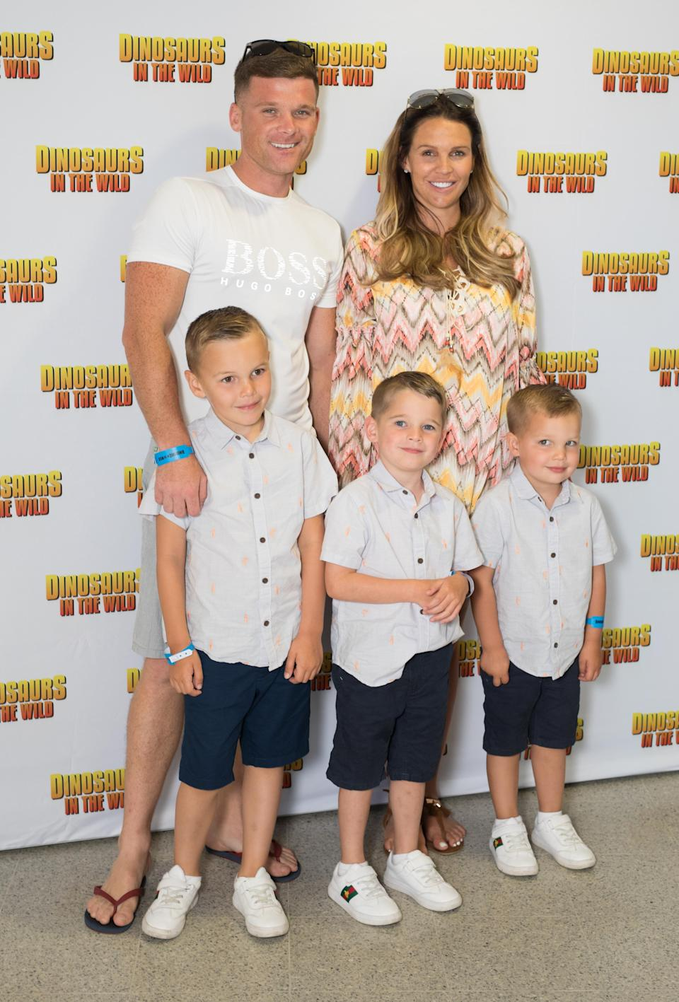 Danielle Lloyd and Michael O'Neill with (left to right) Archie, 7, Harry, 6, and George, 4, attend the launch of Dinosaurs In The Wild at the Birmingham NEC, (PA)