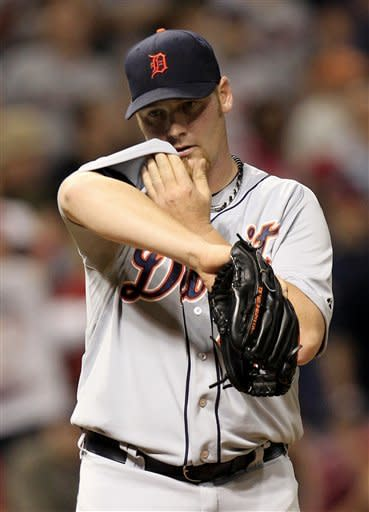 Detroit Tigers pitcher Phil Coke wipes sweat from his face after Cleveland Indians' Jason Kipnis scored in the eighth inning in a baseball game, Wednesday, May 23, 2012, in Cleveland. The Indians won 4-2. (AP Photo/Tony Dejak)