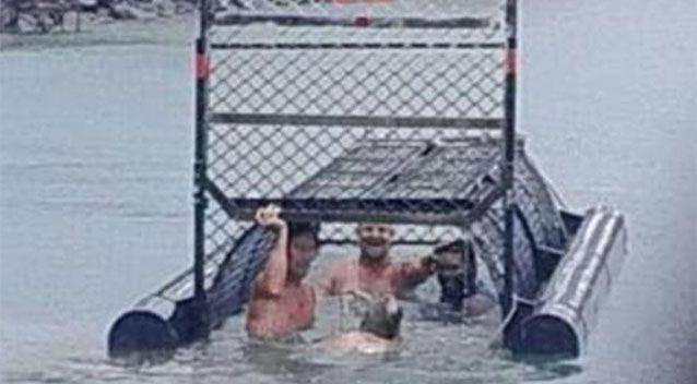 Four men photographed inside a croc trap in Cairns. Source: 7 News