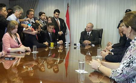 Paraguay's Senate President Acevedo and Supreme Court President Benitez Riera attend a meeting with other senators at the Justice Building in Asuncion