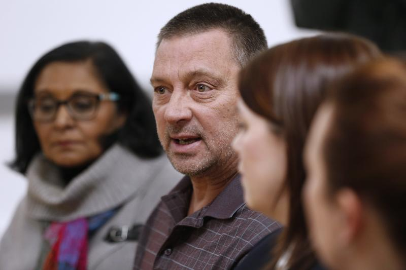 FILE- In this Feb. 9, 2017, file photo, from left, Rita Chahal, Executive Director of Manitoba Interfaith Immigration Council, Greg Janzen, Reeve of Emerson-Franklin, Tara Seel, Royal Canadian Mounted Police and Jeryn Peters, Canada Border Services Agency Chief of Operations Emerson speak to media after a town hall meeting in Emerson, Manitoba. America's neighbor to the north is increasingly being seen as a haven for asylum seekers turned away by the U.S. And some are willing to risk a walk across the border in dangerous cold to get there. (John Woods/The Canadian Press via AP, File)