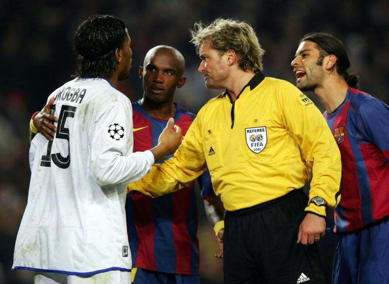 Referee Anders Frisk sends off Didier Drogba (L) of Chelsea during a Champions League match in February 2005