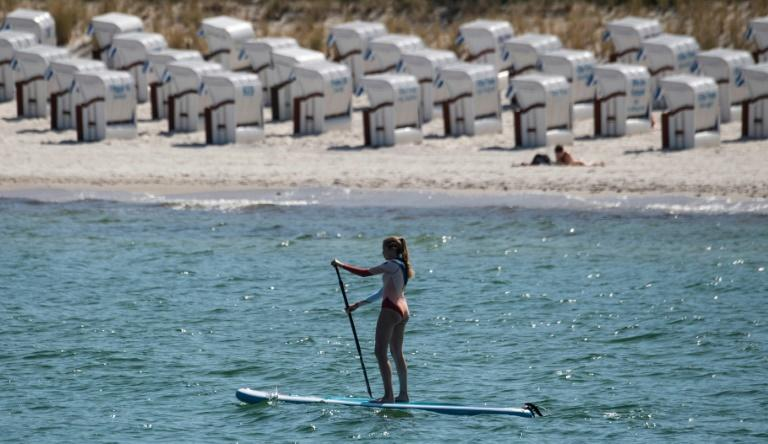 A woman on her paddle board at the seaside resort of Binz, on the island of Ruegen in northeastern Germany