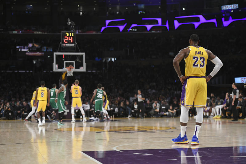 LOS ANGELES, CA - MARCH 09: LeBron James # 23 stands in the backcourt as Moritz Wagner # 15 of the Los Angeles Lakers shoots freethrows agaisnt Boston Celtics at Staples Center on March 9, 2019 in Los Angeles, California. Celtics won 120-107. PLEASE NOTE TO USER: User expressly accepts and agrees that by downloading and using this photograph, the user accepts the terms and conditions of the Getty Images License Agreement. (Photo by John McCoy / Getty Images)