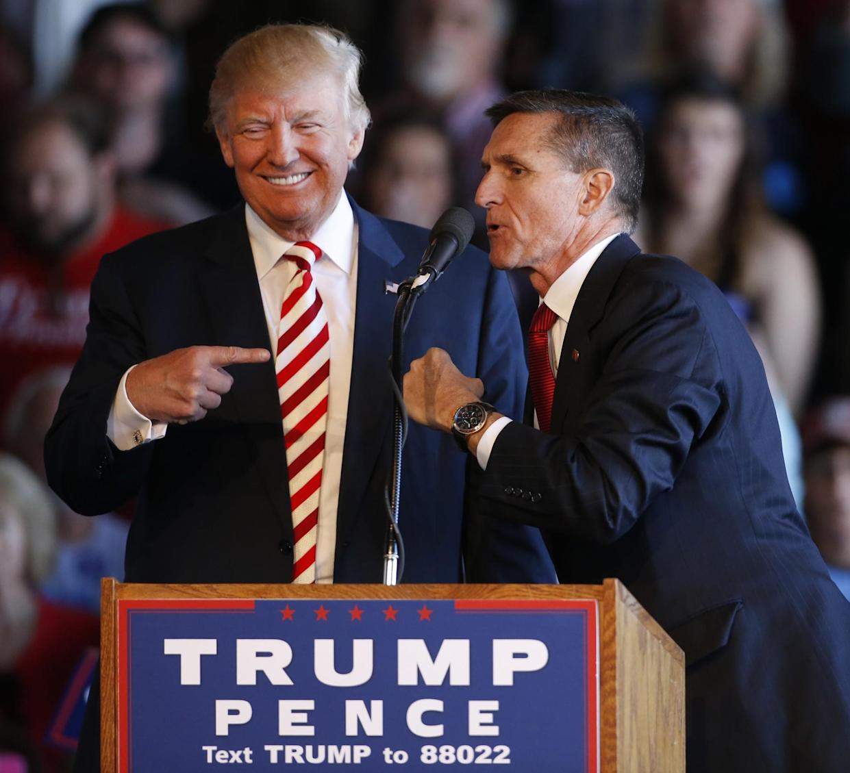 Donald Trump, left, jokes with retired Gen. Michael Flynn at a rally at Grand Junction Regional Airport on Oct. 18, 2016, in Grand Junction, Colo. (Photo: George Frey/Getty Images)