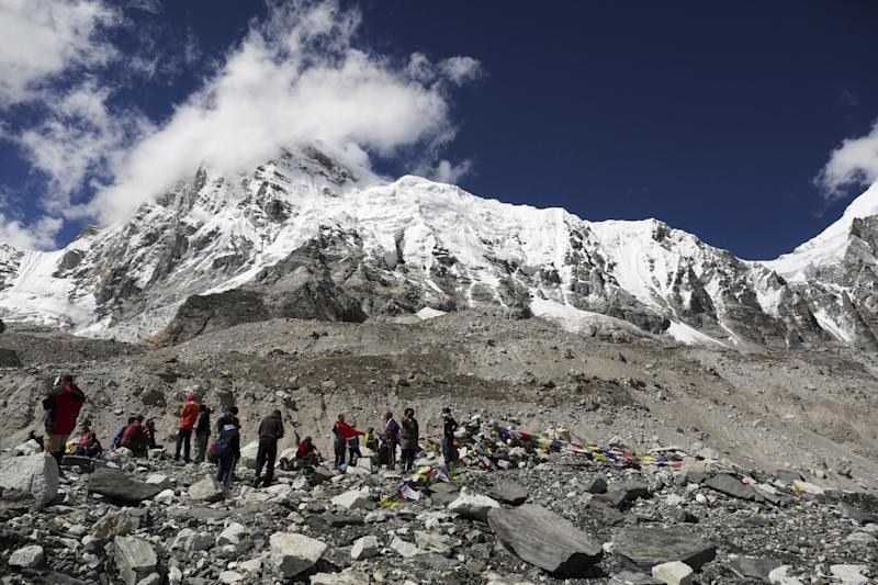 Mount Everest peeks through the clouds in this Sept.