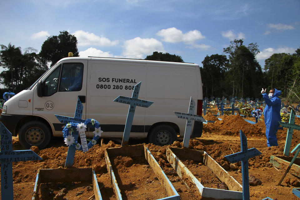 A funeral service vehicle carries the remains of 38-year-old Joana D'arc Marques da Silva, who died of the new coronavirus, who will be buried at the Nossa Senhora Aparecida cemetery in Manaus, Amazonas state, Brazil, Wednesday, Jan. 6, 2021. (AP Photo/Edmar Barros)