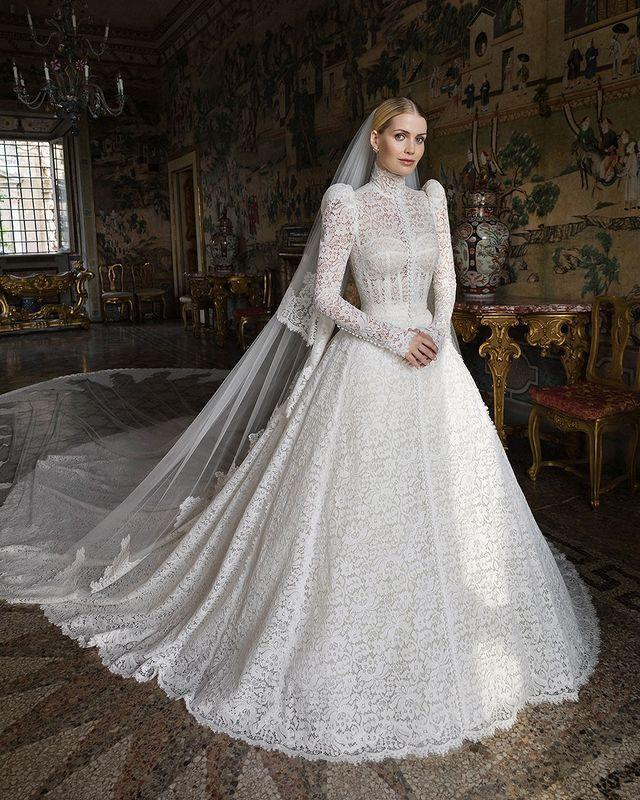 """<p>The blonde looked regal in a lace Victoriana-inspired gown that featured a high neck, corseted bodice and puff sleeves as well as a Cathedral-length train for her nuptials in Rome.</p><p><a href=""""https://www.instagram.com/p/CRwK4gnNd-H/"""" rel=""""nofollow noopener"""" target=""""_blank"""" data-ylk=""""slk:See the original post on Instagram"""" class=""""link rapid-noclick-resp"""">See the original post on Instagram</a></p>"""