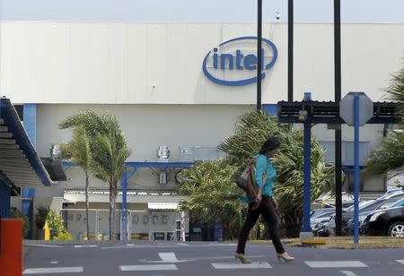 An employee walks inside the Intel microprocessor assembly plant in Heredia