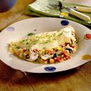 """<p>This hearty omelet is chock full of fresh garden veggies, from tomatoes and zucchini to green bell pepper and sliced mushrooms. <a href=""""https://www.myrecipes.com/how-to/egg-substitute-for-baking"""" rel=""""nofollow noopener"""" target=""""_blank"""" data-ylk=""""slk:Egg substitute"""" class=""""link rapid-noclick-resp"""">Egg substitute</a> and reduced-fat cheese trims fat and calories--but this omelet is so tasty and filling, you'll never know it's healthy. </p>"""