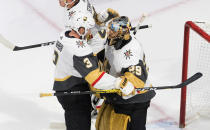 Vegas Golden Knights' Brayden McNabb (3) and goalie Marc-Andre Fleury (29) celebrate the win over the Chicago Blackhawks in an NHL hockey Stanley Cup first-round playoff series, Saturday, Aug. 15, 2020, in Edmonton, Alberta. (Jason Franson/The Canadian Press via AP)