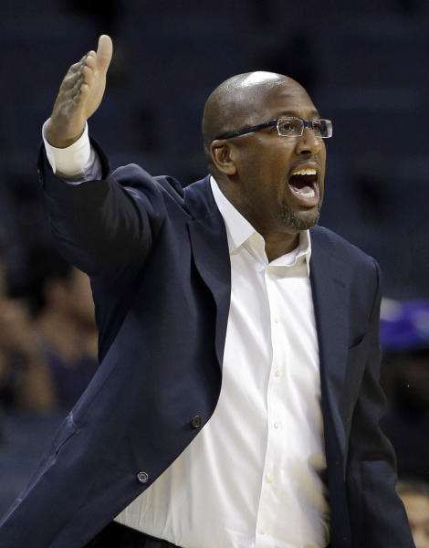 Cleveland Cavaliers head coach Mike Brown directs his team against the Charlotte Bobcats in the first half of a preseason NBA basketball game in Charlotte, N.C., Thursday, Oct. 24, 2013. (AP Photo/Chuck Burton)