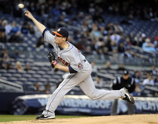 Houston Astros pitcher Lucas Harrell delivers the ball to the New York Yankees during the first inning of a baseball game Monday, April 29, 2013, at Yankee Stadium in New York. (AP Photo/Bill Kostroun)