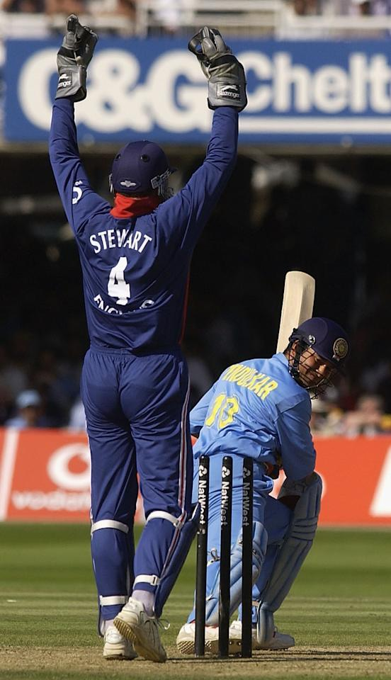 LONDON, ENGLAND - JULY 13:  Alec Stewart of England celebrates as Sachin Tendulkar of India is clean bowled by Ashley Giles during the match between England and India in the NatWest One Day Series Final at Lord's in London, England on July 13, 2002. (Photo by Tom Shaw/Getty Images)