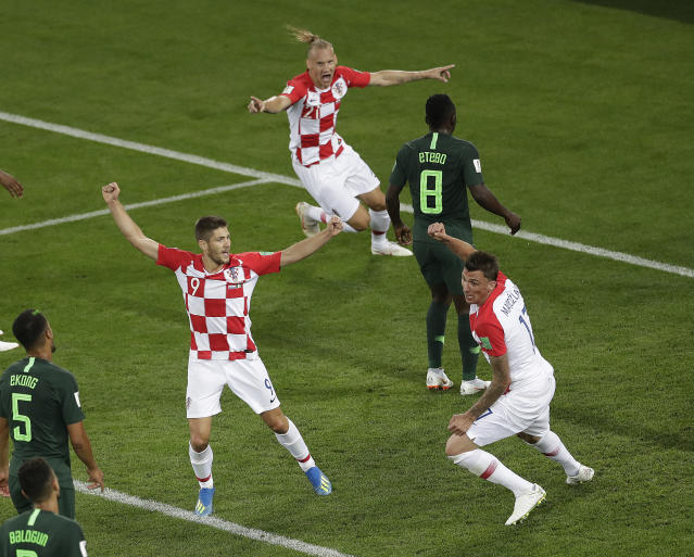 <p>Contrasting emotions: Croatia celebrate the goal, while Oghenekaro Etebo is left distraught. (AP) </p>