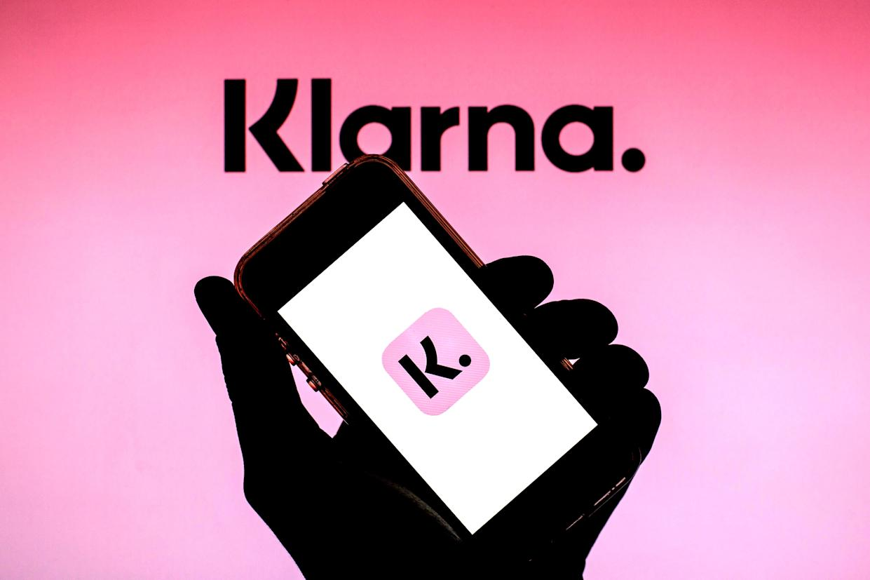 In this photo illustration of a Klarna Bank AB logo seen displayed on a smartphone with the Klarna Bank AB logo in the background. (Photo by Thiago Prudencio / SOPA Images/Sipa USA)