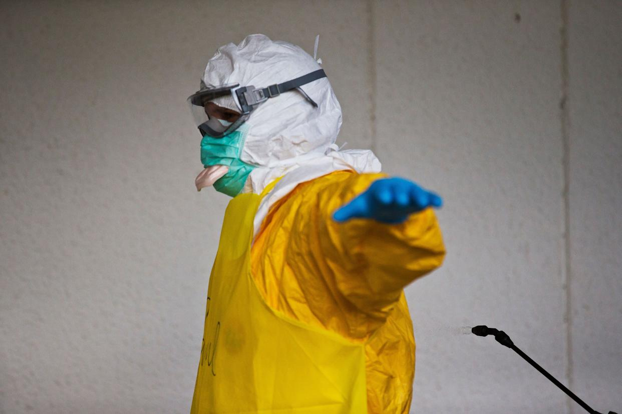 A licensed clinician is sprayed for contaminants during a simulated training session on Monday, Oct. 6, 2014, in Anniston, Ala. The Centers for Disease Control and Prevention (CDC) has developed an introductory training course for licensed clinicians. According to the CDC, the course is to ensure that clinicians intending to provide medical care to patients with Ebola have sufficient knowledge of the disease. (AP Photo/Brynn Anderson)
