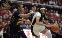 Stanford guard Haley Jones, right, drives the ball as California guard Jazlen Green (10) defends during the first half of an NCAA college basketball game Friday, Jan. 10, 2020, in Stanford, Calif. (AP Photo/Ben Margot)