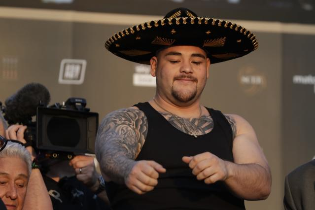 "Heavyweight boxer Andy Ruiz Jr. of Mexico poses during a weigh-in at Faisaliah Center, in Riyadh, Saudi Arabia, Friday, Dec. 6, 2019. The first ever heavyweight title fight in the Middle East, has been called the ""Clash on the Dunes."" Will take place at the Diriyah Arena on Saturday. (AP Photo/Hassan Ammar)"
