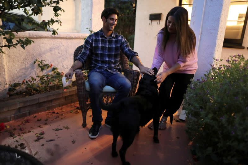 FILE PHOTO: Dr. Zafia Anklesaria greets her husband, Aryan Jafari and their dog as she arrives home in Los Angeles