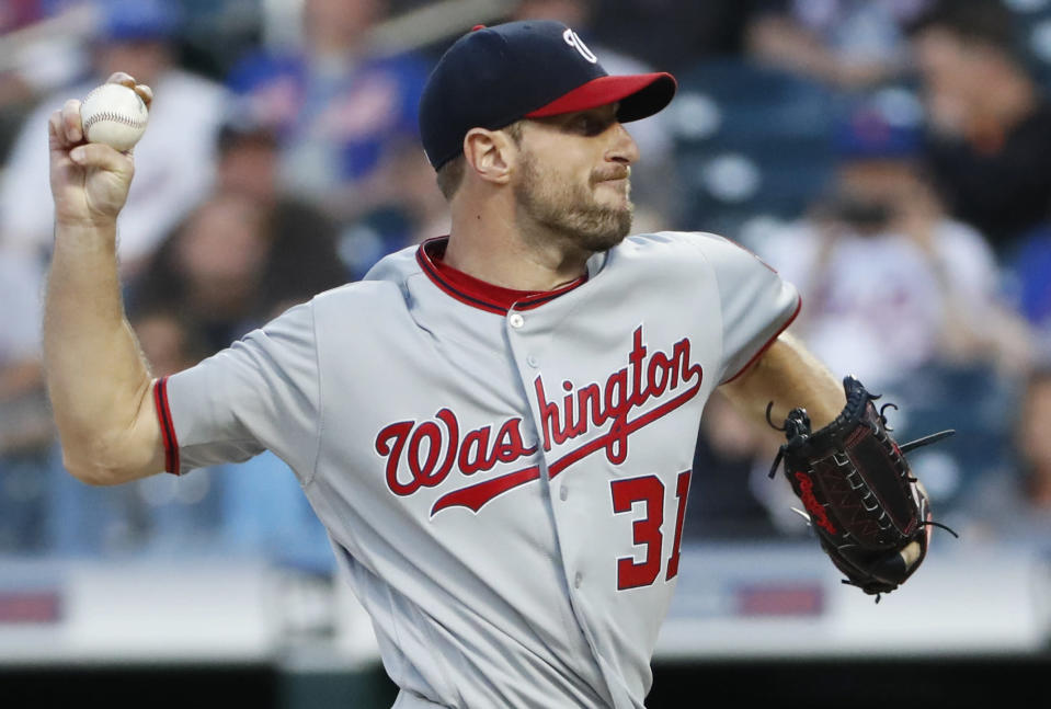 Washington Nationals starting pitcher Max Scherzer winds up during the first inning of the team's baseball game against the New York Mets, Wednesday, May 22, 2019, in New York. (AP Photo/Kathy Willens)