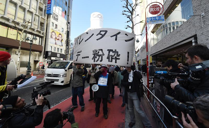 Ten killjoys hold a banner, reading 'Smash Valentine's Day', march during a demonstration around Tokyo's Shibuya shopping district, on February 14, 2015 (AFP Photo/Toshifumi Kitamura)