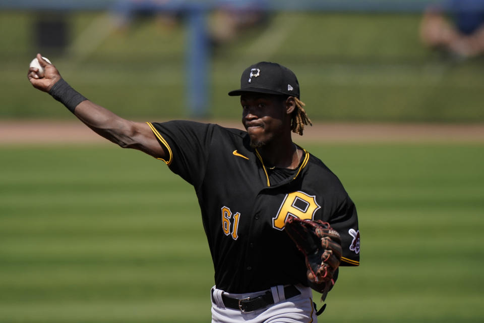 Pittsburgh Pirates shortstop Oneil Cruz throws the ball during a play in the second inning during a spring training baseball game against the Tampa Bay Rays on Wednesday, March 3, 2021, in Port Charlotte, Fla. (AP Photo/Brynn Anderson)
