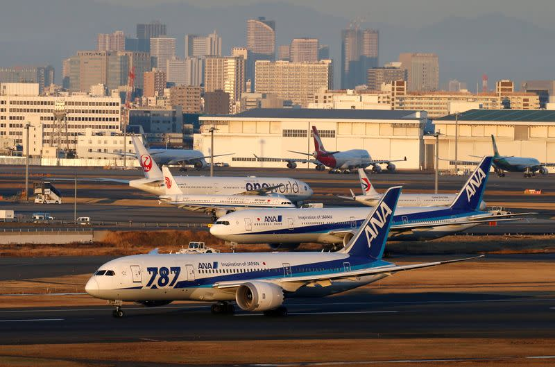 FILE PHOTO: ANA's Boeing 787 taxis in front of other aircraft at the Tokyo International Airport in Tokyo