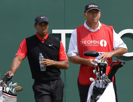 FILE PHOTO: Tiger Woods of the U.S. (L) stands behind his former caddie Steve Williams at the start of his final round of the British Open golf Championship at Muirfield in Scotland July 21, 2013. REUTERS/Russell Cheyne/File Photo