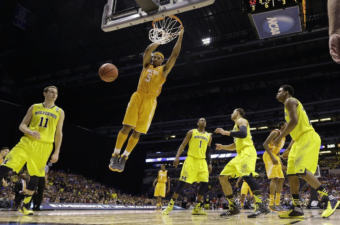Tennessee's Jarnell Stokes dunks during the second half of an NCAA Midwest Regional semifinal college basketball tournament game against the Michigan Friday, March 28, 2014, in Indianapolis. (AP Photo/David J. Phillip)
