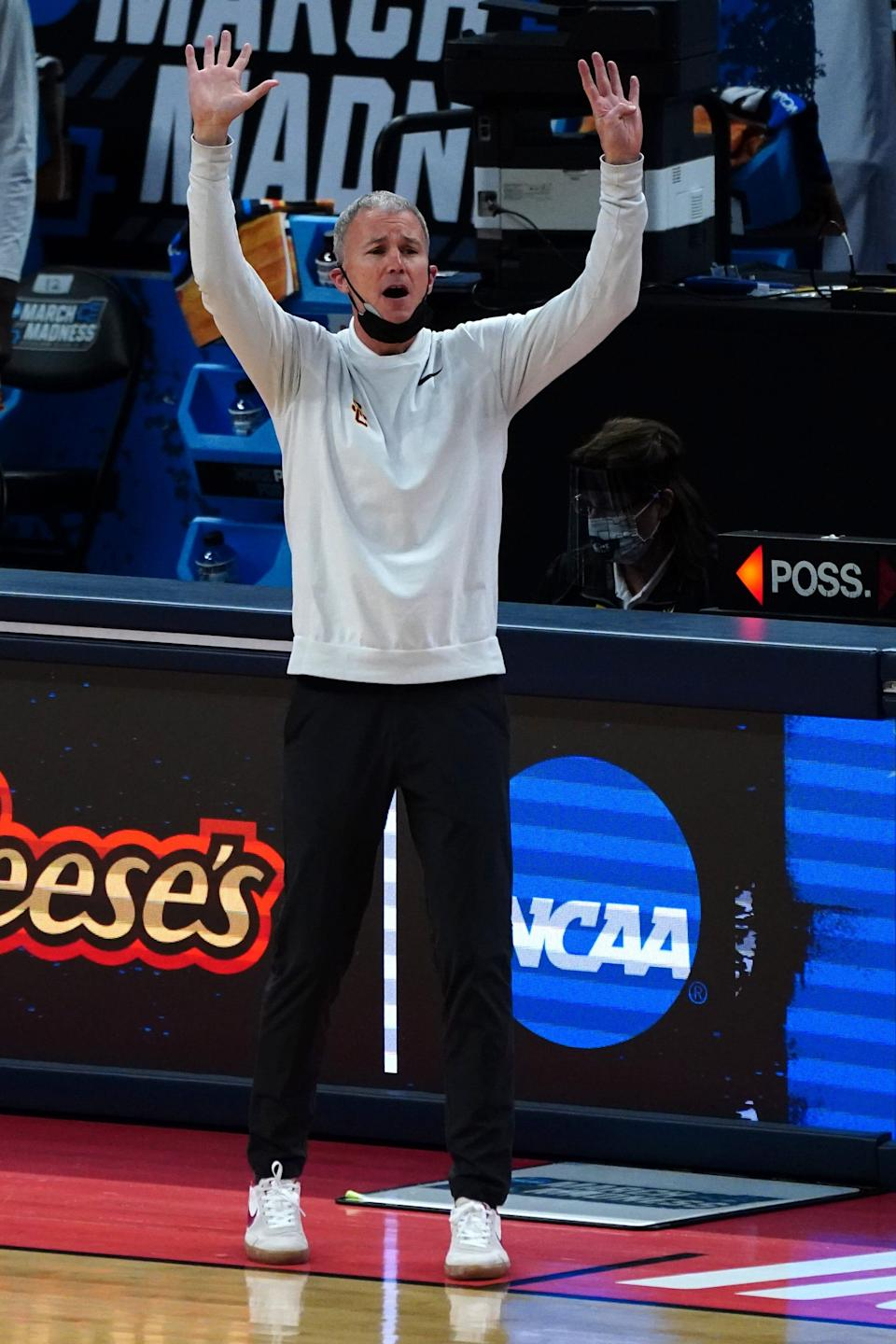 USC head coach Andy Enfield gestures from the sideline during the Tojan's first-round game agaist Drake.