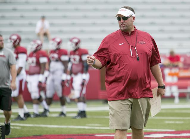 Arkansas head coach Bret Bielema gives instruction to a group of offensive players during a preseason NCAA college football practice at Donald W. Reynolds Razorback Stadium in Fayetteville, Ark., Saturday, Aug. 16, 2014. (AP Photo/Gareth Patterson)