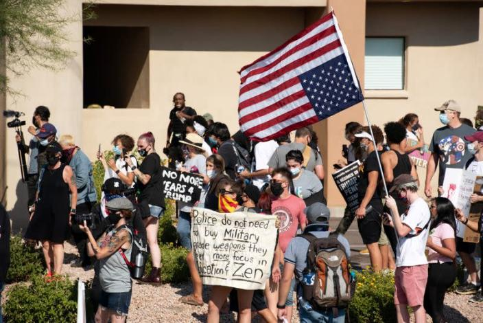 Protestors chant the visit by U.S. President Donald Trump to the Dream City Church in Phoenix