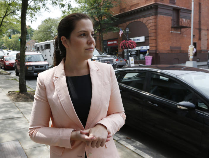 Then-Republican congressional candidate Elise Stefanik walks the business district in Ballston Spa, N.Y., in 2014. (Photo: Mike Groll/AP)