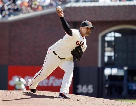 San Francisco Giants' Petit winds up during the second inning of MLB exhibition baseball game against the Oakland Athletics in San Francisco