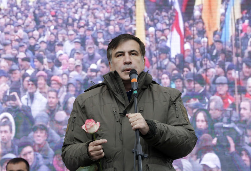 FILE - In this Tuesday, Nov. 7, 2017 file photo, former Georgian President Mikheil Saakashvili speaks to his supporters during a rally outside the Ukrainian parliament in Kiev, Ukraine. Former Georgian President Mikhail Saakashvili, who now heads a Ukrainian opposition party, said Monday Nov. 20, 2017, he's ready to become the new prime minister, after organising a series of street protests against President Petro Poroshenko, accusing him of stalling reforms and covering up corruption. (AP Photo/Efrem Lukatsky, FILE)