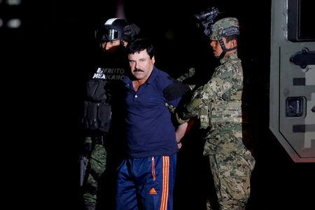 "FILE PHOTO: FILE PHOTO: Joaquin ""El Chapo"" Guzman is escorted by soldiers during a presentation in Mexico City"
