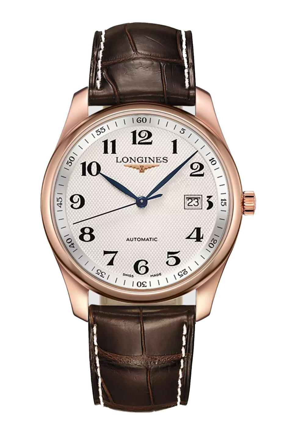 """<p><strong>Longines</strong></p><p>longines.com</p><p><strong>$6500.00</strong></p><p><a href=""""https://www.longines.com/en-us/watch-the-longines-master-collection-l2-793-8-78-3"""" rel=""""nofollow noopener"""" target=""""_blank"""" data-ylk=""""slk:Shop Now"""" class=""""link rapid-noclick-resp"""">Shop Now</a></p><p>Simple and refined, with just a touch of the blended gold finish.</p>"""