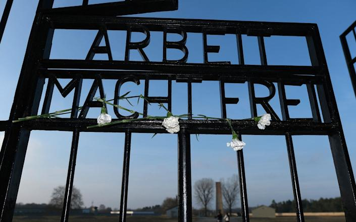 Work sets you free - the notorious slogan at the entrance to Auschwitz - Getty Images Europe