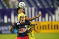 Nashville SC midfielder Anibal Godoy, top, heads the ball away from New England Revolution forward Diego Fagundez during the first half of an MLS soccer match Friday, Oct. 23, 2020, in Nashville, Tenn. (AP Photo/Mark Humphrey)