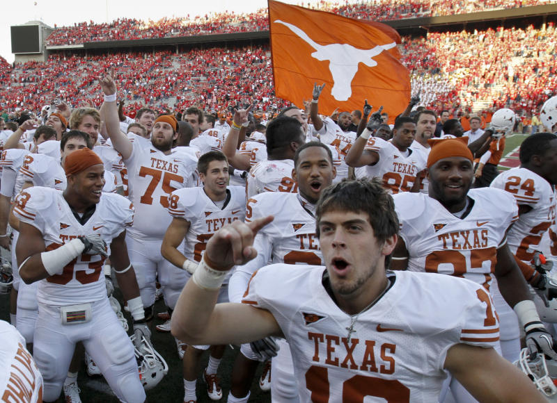 Texas players, including Justin Tucker, foreground, celebrate their 20-13 win over No. 5 Nebraska in an NCAA college football game in Lincoln, Neb., Saturday, Oct. 16, 2010. (AP Photo/Nati Harnik)