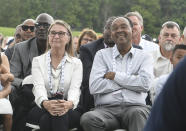 Dot Jeter, left, and Charles Jeter, parents of Hall of Fame inductee Derek Jeter, listen as he speaks during an induction ceremony at the Clark Sports Center on Wednesday, Sept. 8, 2021, at the National Baseball Hall of Fame in Cooperstown, N.Y. (AP Photo/Hans Pennink)