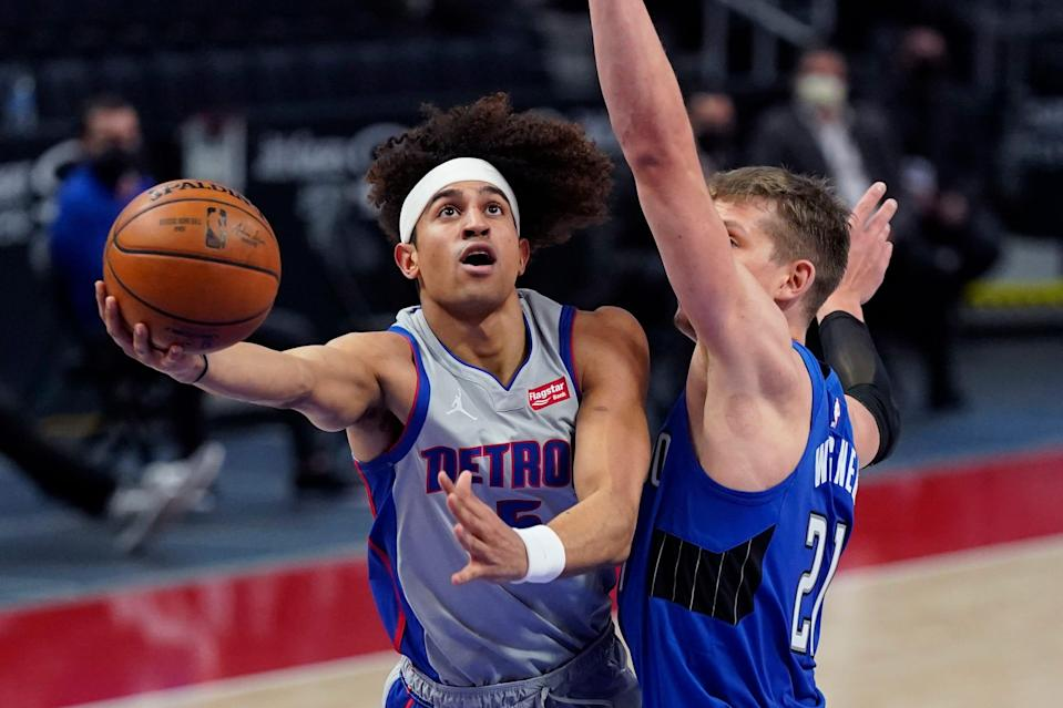 Pistons guard Frank Jackson makes a layup as Magic center Moritz Wagner defends during the first half on Monday, May 3, 2021, at Little Caesars Arena.