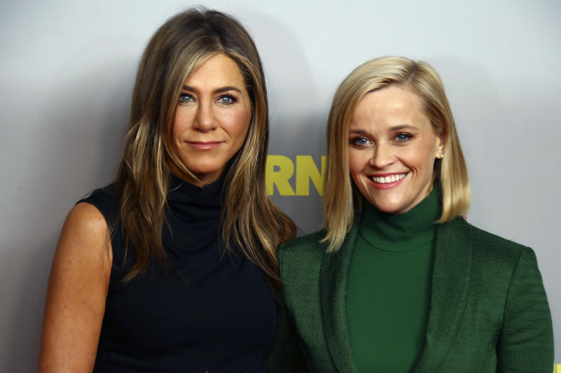 Actresses and producers Jennifer Aniston, left, and Reese Witherspoon, pose for photographers upon arrival at the photo call of 'The Morning Show' at a central London hotel, Friday, Nov. 1, 2019. (Photo by Joel C Ryan/Invision/AP)