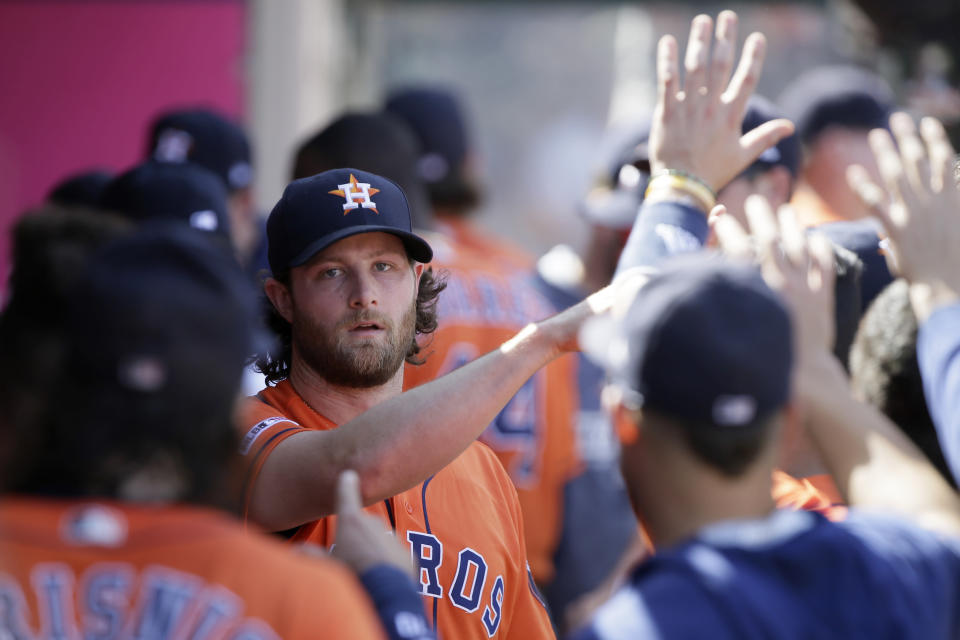 Houston Astros starting pitcher Gerrit Cole gets congratulations from teammates after the fifth inning of a baseball game against the Los Angeles Angels in Anaheim, Calif., Sunday, Sept. 29, 2019. (AP Photo/Alex Gallardo)