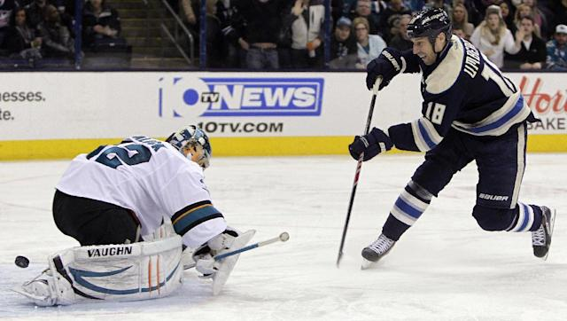 Columbus Blue Jackets' RJ Umberger, right, scores a short-handed goal against San Jose Sharks' Alex Stalock during the second period of an NHL hockey game, Thursday, March 13, 2014, in Columbus, Ohio. (AP Photo/Jay LaPrete)